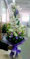 Престиж Состав букета: орхидея цимбидиум, фрезия- 10 шт, эустома- 10 шт, тюльпан- 10 шт, зелень. Размер: 60 см.