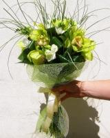 Лимонный вкус Состав букета: фрезия белая- 10 шт, орхидея цимбидиум- 1 ветка, аспидистра, берграсс. Размер: 55 см.