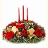Рождественская ночь Состав: роза- 11 шт, ветки елочные, свечи- 3шт, декор. Размер: 40 см.