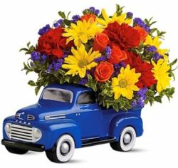 Birght_flowers_in_a_ceramic_48_F-1_Ford_pickup_truck